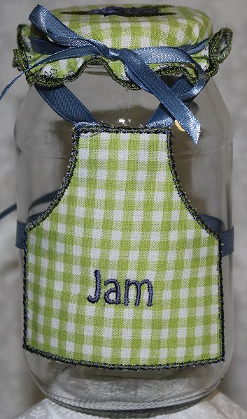 Image of bottle_with_topper_and_apron_1.jpg