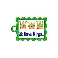 """We three kings"" embroidery design with a tag."